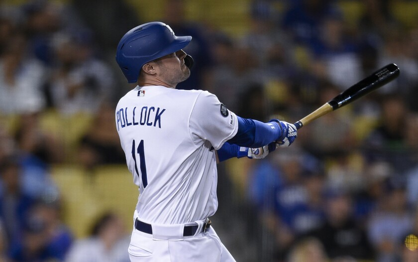 Dodgers left fielder A.J. Pollock hits his third home run of the game.