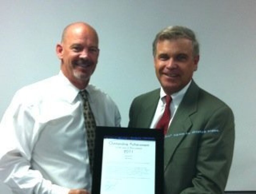 Bruce Zipf, right, presents an Outstanding Performance Award to Jeff Nunn. Photo: Courtesy