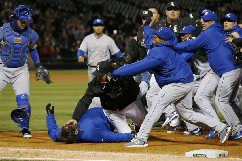Chicago White Sox's Jeff Samardzija, center, tussles with Kansas City Royals players during the seventh inning of a baseball game Thursday, April 23, 2015, in Chicago. (AP Photo/Andrew A. Nelles)