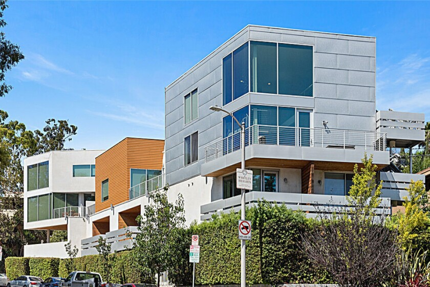 One of nine units in a modern complex, the glass-and-concrete condo holds three bedrooms in roughly 2,000 square feet.