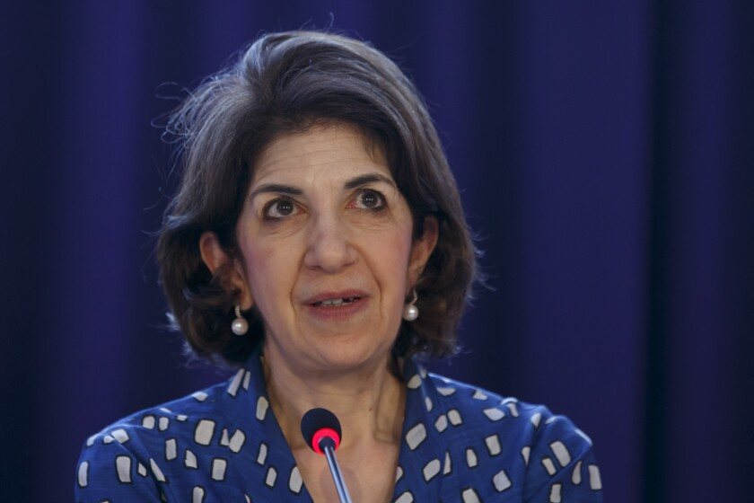 FILE - In this Monday, Sept. 2, 2019 file photo, Fabiola Gianotti, Director General of the European Organization for Nuclear Research (CERN), informs the media of the CERN Open Days, during a press conference at the European Organization for Nuclear Research (CERN) in Meyrin near Geneva, Switzerland. CERN, the European research center that runs the world's largest atom smasher says it has reappointed Italian physicist Fabiola Gianotti, its first woman chief, for a new five-year term, beginning Jan. 1, 2021. (Salvatore Di Nolfi/Keystone via AP, File)