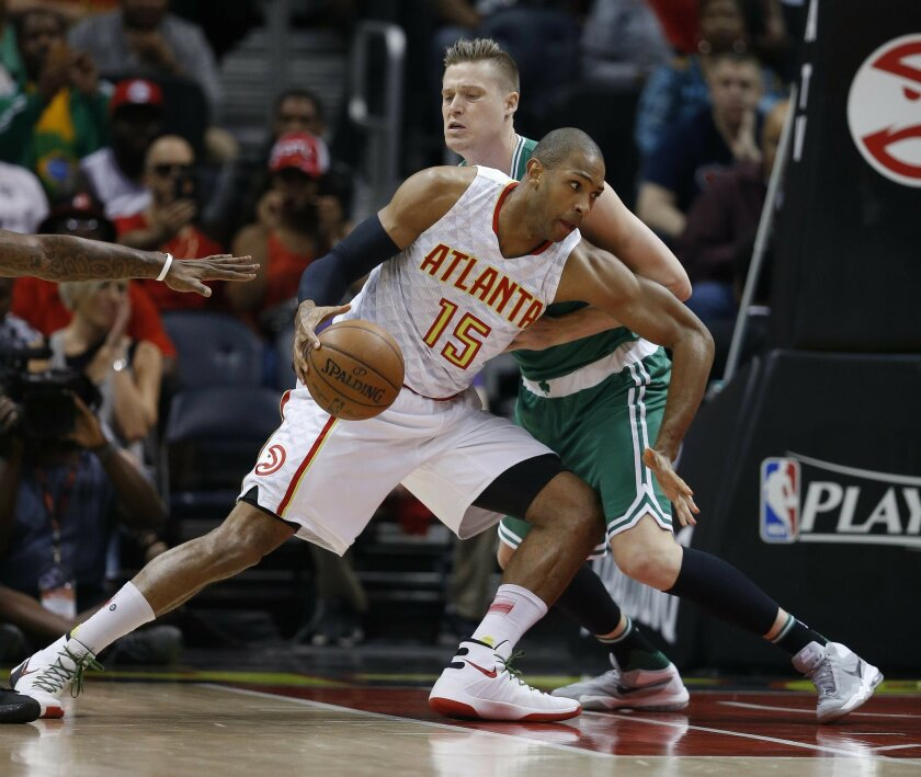 FILE - In this April 26, 2016, file photo, Atlanta Hawks center Al Horford (15) drives against Boston Celtics forward Jonas Jerebko during the first half of Game 5 of an NBA basketball first-round playoff series in Atlanta. (Toronto's DeMar DeRozan, Atlanta's Al Horford, Memphis point guard Mike Co