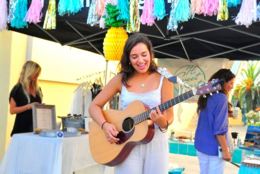Eliza Rose Vera performs for passersby on Prospect Street.