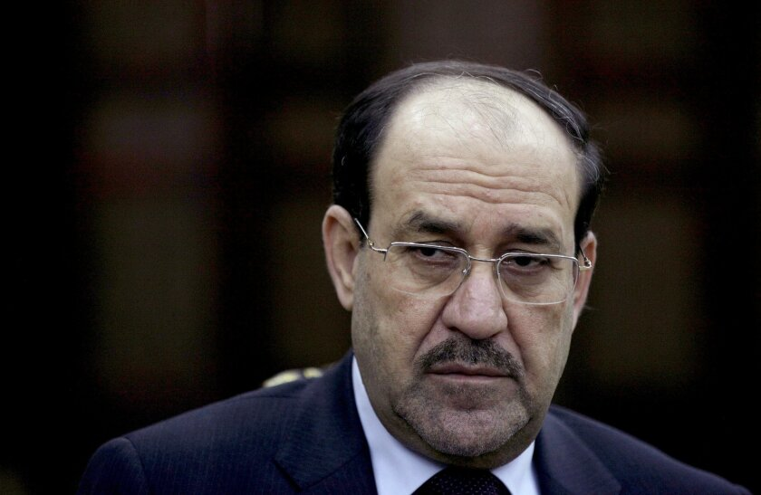 FILE - In this Wednesday, Feb. 27, 2013, file photo, Iraqi Prime Minister Nouri al-Maliki listens to a question during an interview with The Associated Press in Baghdad. On Tuesday, Aug. 12, 2014, al-Maliki ordered security forces not to intervene in the current political crisis over who will be the next prime minister, but rather focus on defending the country, which is under attack by Sunni militants in the north. (AP Photo/ Khalid Mohammed, File)