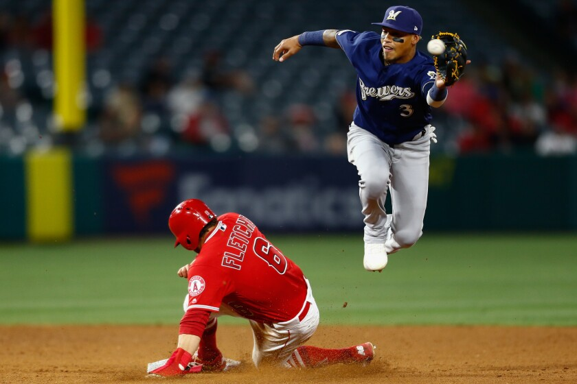ANAHEIM, CALIF. - APRIL 10: Los Angeles Angels third baseman David Fletcher (6) beats the throw to M
