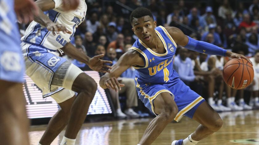 UCLA's Jaylen Hands (4) moves the ball against North Carolina during the second half of an NCAA coll