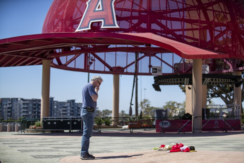 ANAHEIM, CALIF. -- MONDAY, JULY 1, 2019: After placing a bouquet of flowers, Angel fan Bob Horan, of