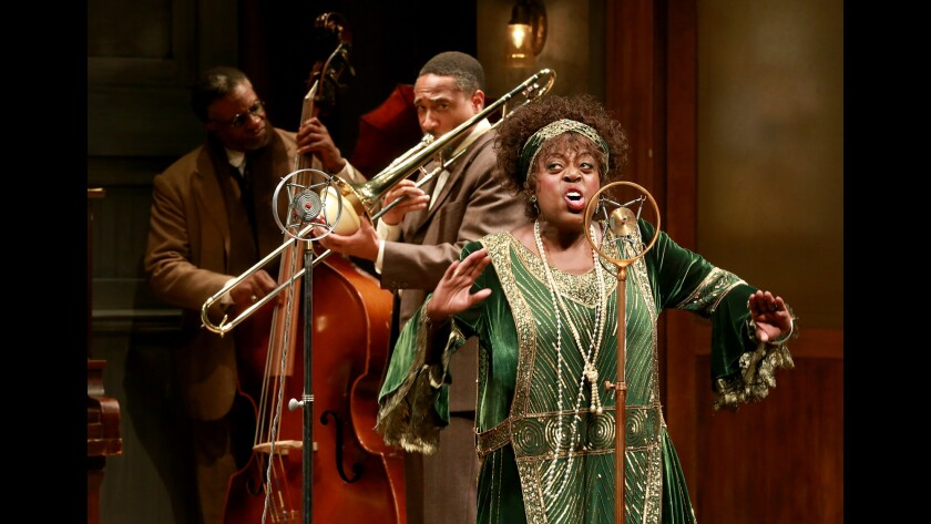 Lillias White as Ma Rainey and musicians Slow Drag (Keith David), left, and Culter.