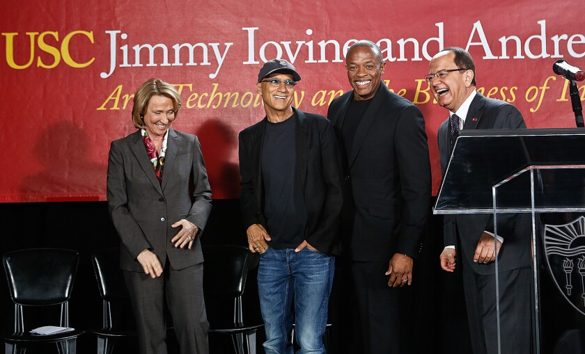 From left, USC dean Erica Muhl, music mogul Jimmy Iovine, rapper Dr. Dre (given name Andre Young) and USC President C.L. Max Nikias at the May 2013 launch event for the USC Jimmy Iovine and Andre Young Academy for Arts, Technology and the Business of Innovation.