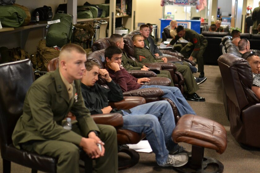 New recruits fresh out of boot camp watch TV at the old USO center at the San Diego airport.