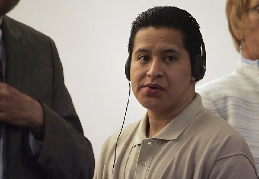 Jose Maurice Castenada watches the jury enter the courtroom for the start of his murder trial in Vista Superior Court.