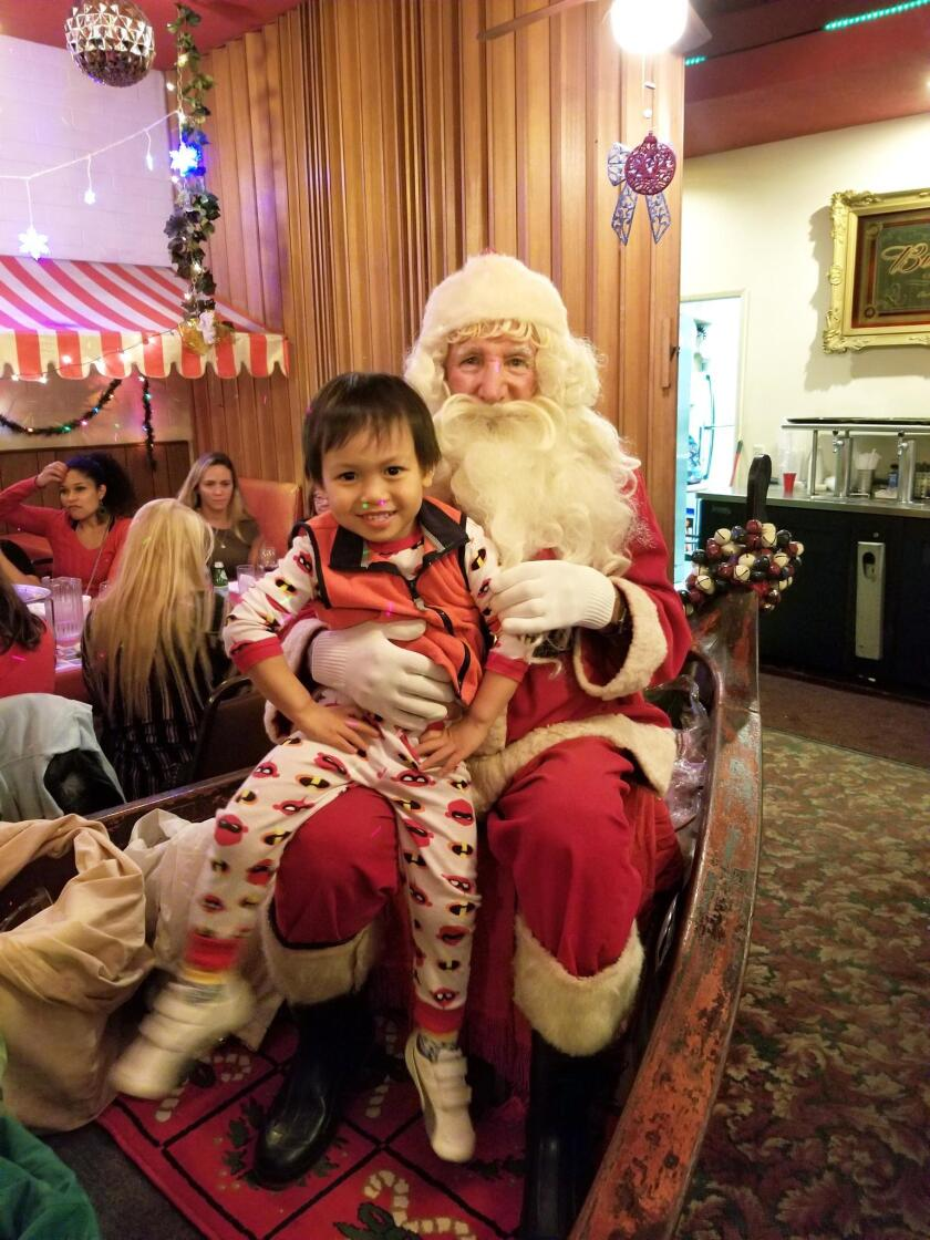 Chris Yen smiles with Santa John.