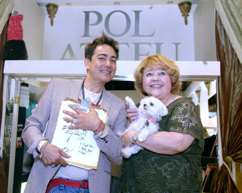 Designer Pol Atteu, left, wants to keep the dress design for Emmy-nominated actress Patrika Darbo, right, a secret, at his design boutique in Beverly Hills on Tuesday, Aug. 9, 2016.