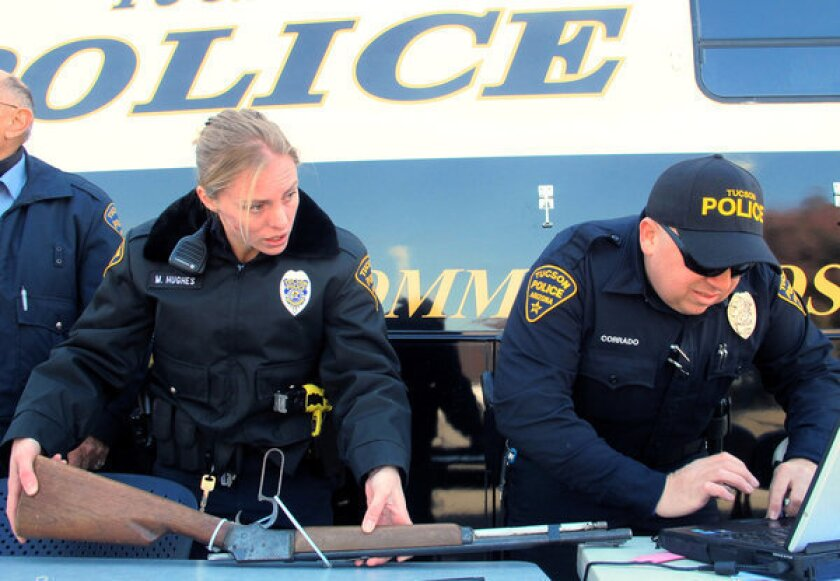 Tucson police officers catalog weapons at a gun buyback program in January. Ariz. Gov. Jan Brewer has signed legislation that prohibits cities and counties from destroying any guns that come into their possession -- part of a broader movement to limit gun buybacks.