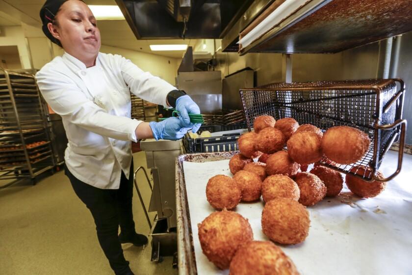 Mara Serrano fries potato balls at Porto's Bakery & Cafe in Glendale.