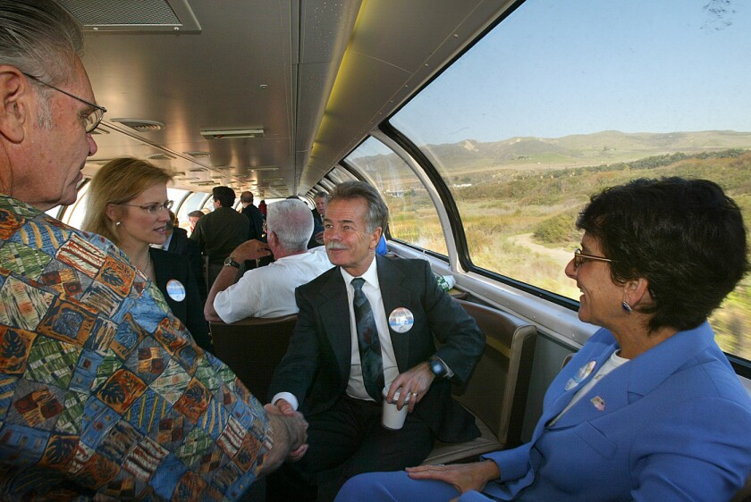 Will Kempton, then-director of the California Department of Transportation, greets dignitaries during a kickoff event for new train service to San Luis Obispo in 2004. Kempton, who is retiring, called the condition of the state's roads the worst he's ever seen.