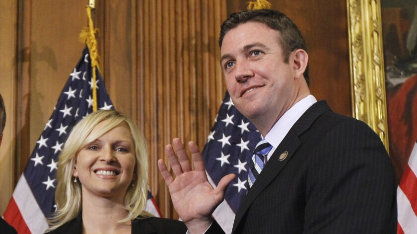 Rep. Duncan Hunter and his wife, Margaret, who is paid $3,000 a month in campaign funds to serve as his campaign manager.