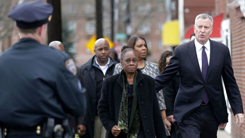 New York City Mayor Bill de Blasio and his wife, Chirlane McCray, arrive at funeral services for Timothy Caughman on April 1 in New York.