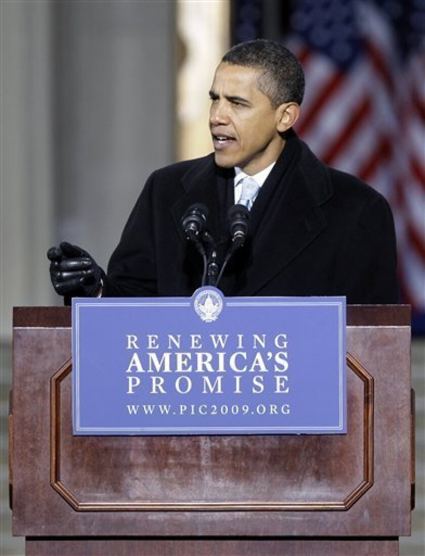 President-elect Barack Obama speaks at the War Memorial Plaza during his whistle stop train trip, Saturday, Jan. 17, 2009, in Baltimore.  (AP Photo/Rob Carr)