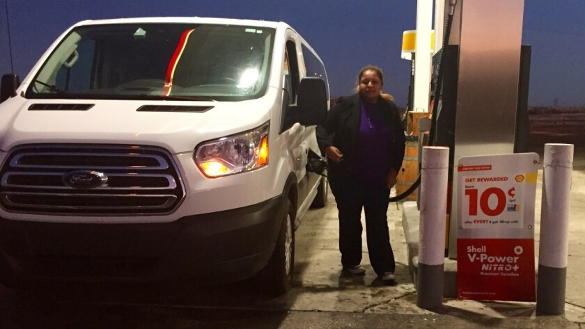 SEIU organizer Jasmin Castillo puts gas in a van full of sleeping janitors near the Nevada state line. The van left Los Angeles after 3 a.m. Saturday, right after their shifts ended.