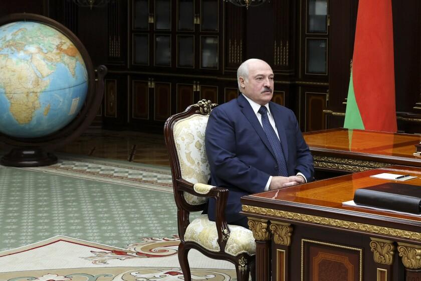 CORRECTING DATE - Belarus President Alexander Lukashenko listens to his son, President of the Belarusian National Olympic Committee Viktor Lukashenko in Minsk, Belarus, Tuesday June 8, 2021. (Sergei Shelega/BelTA Pool Photo via AP, File)