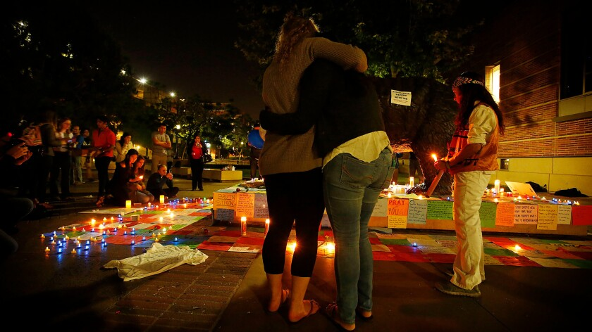 UCLA students hold a vigil as the community mourns the sudden and tragic deaths of two people on campus.