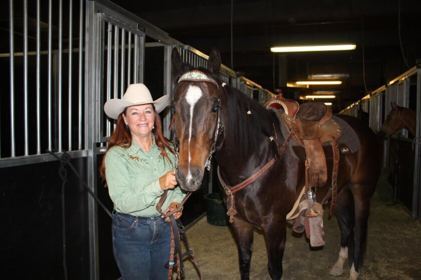 Barrel racer Linda Stenerson pictured with Cody, one of her former barrel-racing horses, at the Super Show in Las Vegas in May 2012. CREDIT: Selena Roberts