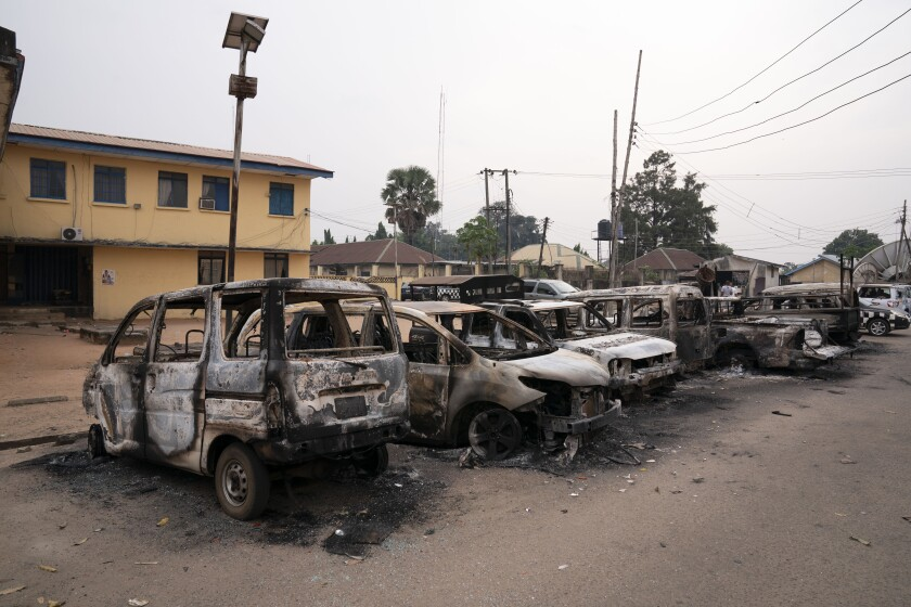 Burned vehicles are parked outside the police command headquarters in Owerri, Nigeria, on Monday, April 5, 2021. Hundreds of inmates escaped from a prison in the southeastern Nigerian city after a series of coordinated attacks, according to government officials. (AP Photo/David Dosunmu)