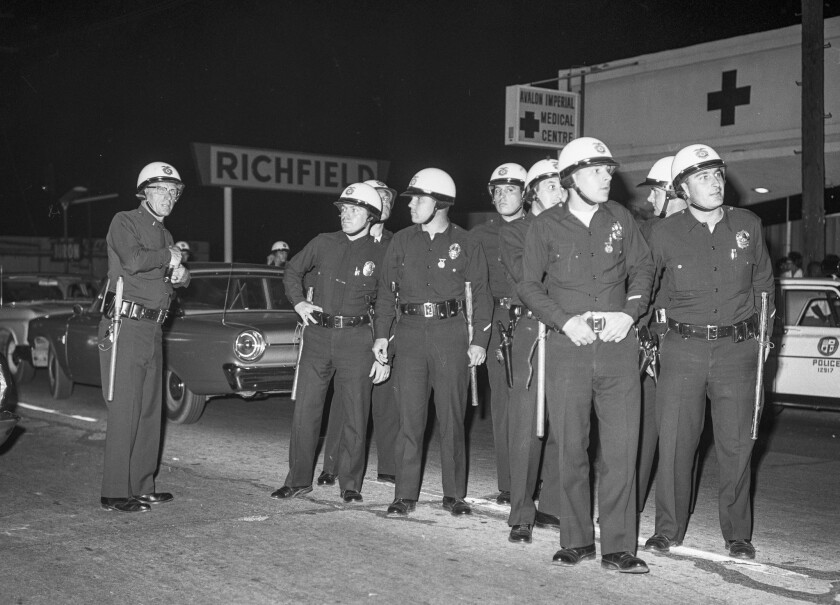 A group of Los Angeles police officers stand together during the Watts riots on Aug. 11, 1965.