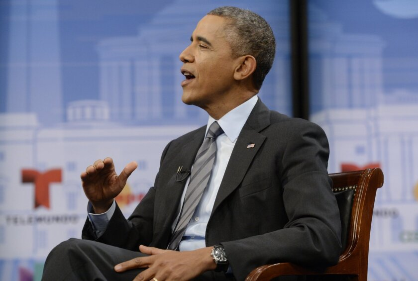 President Obama touts the benefit of health coverage at a town hall event this month in Washington.