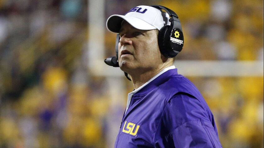 Former LSU coach Les Miles has been hired to lead Kansas' downtrodden football program. Miles spent 11 years at LSU, winning a national championship in 2007, before being fired four games into the 2016 season.