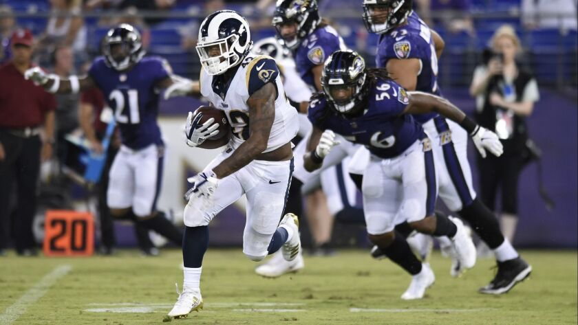 Los Angeles Rams running back John Kelly rushes the ball in the second half of a preseason NFL footb
