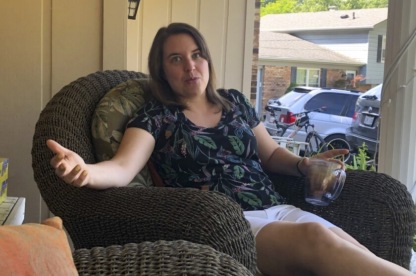 In this July 17, 2020, photo Andrea Granieri, a lifelong Republican, talks about her opposition to President Donald Trump as she sits on her front porch in the Cincinnati suburb of Anderson Township. (AP Photo/Dan Sewell)