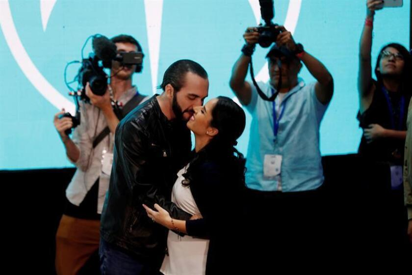 Candidate of the GANA (Great Alliance for National Unity) for the Presidency of El Salvador Nayib Bukele (C-L) and his wife Gabriele de Bukele (C-R), kiss during a press conference in San Salvador, El Salvador, Feb.3, 2019. EPA-EFE/ESTEBAN BIBA