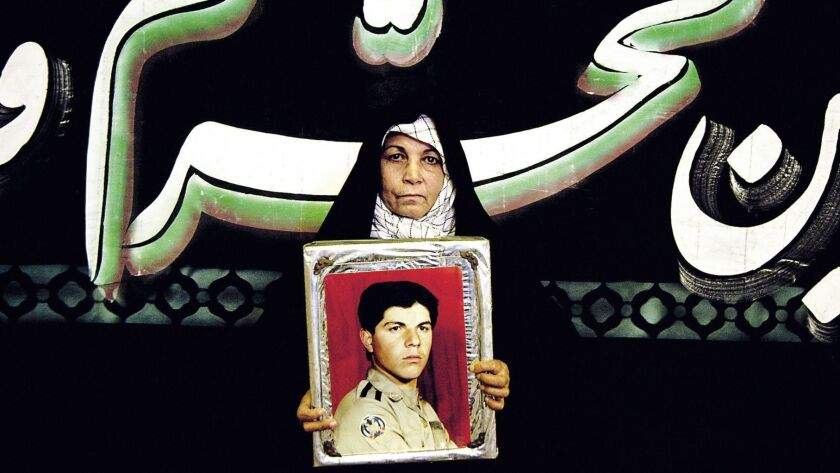 """Newsha Tavakolian's """"Mothers of Martyrs"""" (detail), 2006. The photo is part of the upcoming exhibition """"In the Fields of Empty Days: The Intersection of Past and Present in Iranian Art"""" at the Los Angeles County Museum of Art."""