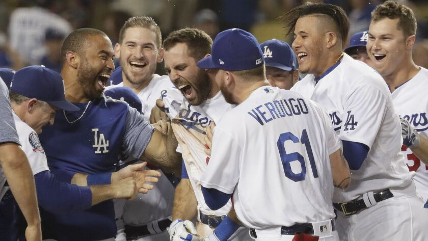 LOS ANGELES, CA, TUESDAY, SEPTEMBER 18, 2018 - Teammates mob Dodgers second baseman Chris Taylor af