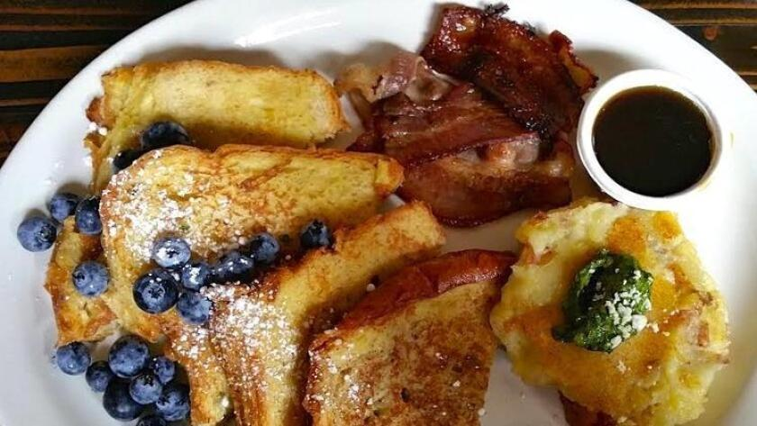 French toast with fresh berries, house smoked pork belly and fluffy potato cake at Nate's Garden Grill. (Amy T. Granite)