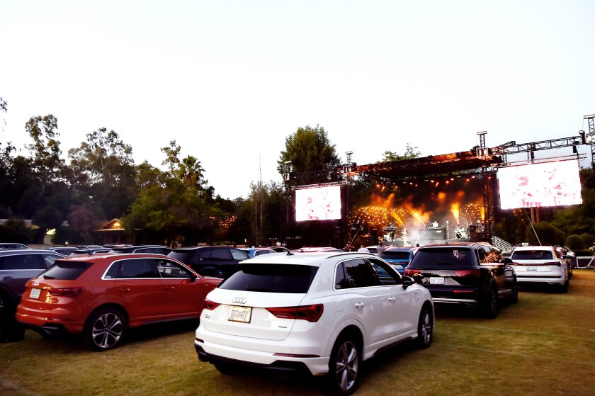 Cars are lined up for Audi Presents: Summer Drive-in Concert featuring Kehlani at Calamigos Ranch in Malibu.