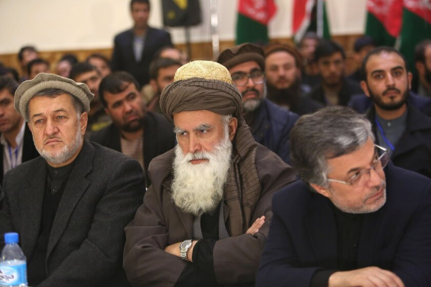 Former Afghan warlord Abdul Rasool Sayyaf, center, attends the inauguration of the Afghanistan Protection and Stability Council in Kabul, Afghanistan, Friday, Dec. 18, 2015. It is the first opposition party to be established since the Taliban were toppled in 2001.(AP Photo/Rahmat Gul)