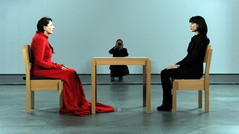 Marina Abramovic, left, during her performance 'The Artist is Present'