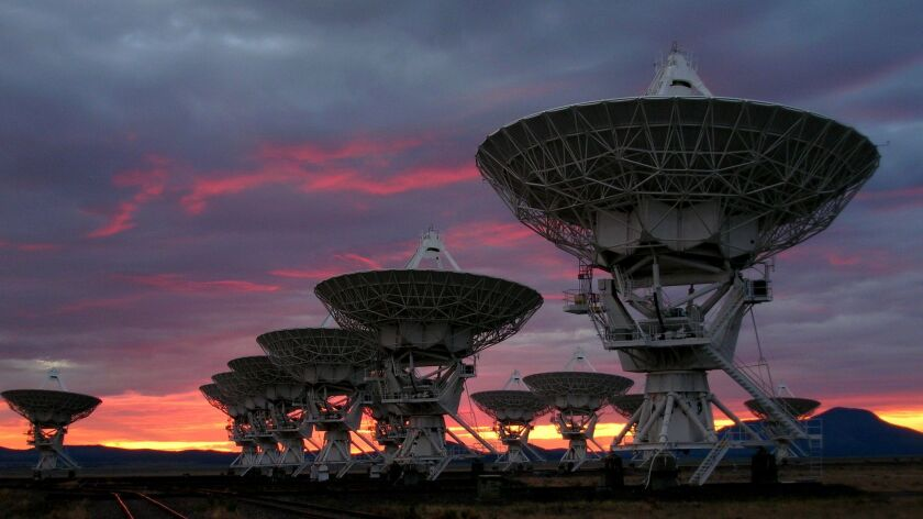 The Very Large Array (VLA) radio telescope at sunrise. The VLA is a collection of 27 radio antenn