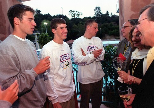 A very youthful Michael Phelps, second from left, and other Olympic team members get a send-off at the Rose Bowl Aquatics Center in Pasadena after training for the 2000 Sydney Games.