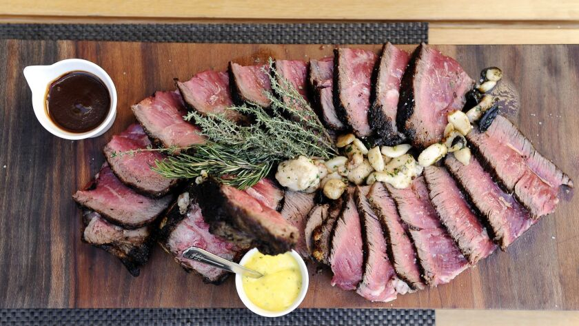 BEVERLY HILLS, CA- September 3, 2016: A 34 Oz Porterhouse with adds of Black & Golden Caramelized G