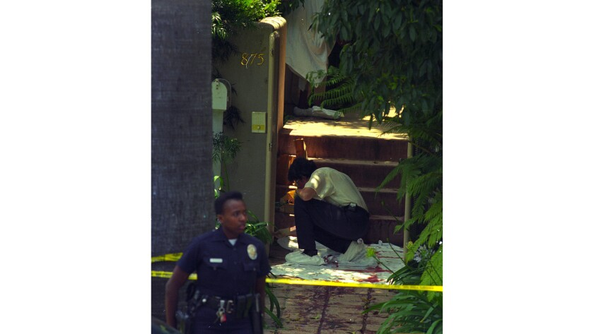 Nicole Brown Simpson's body was found outside her home at 875 S. Bundy Drive in Brentwood. Police examine the area where her body was found.