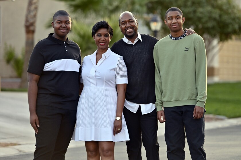 Christian Shelton, his mother, father and older brother