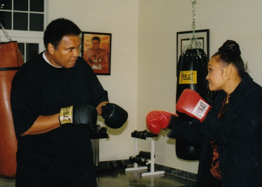 Maryum Ali play fights with her father, Muhammad Ali, in an undated photo.