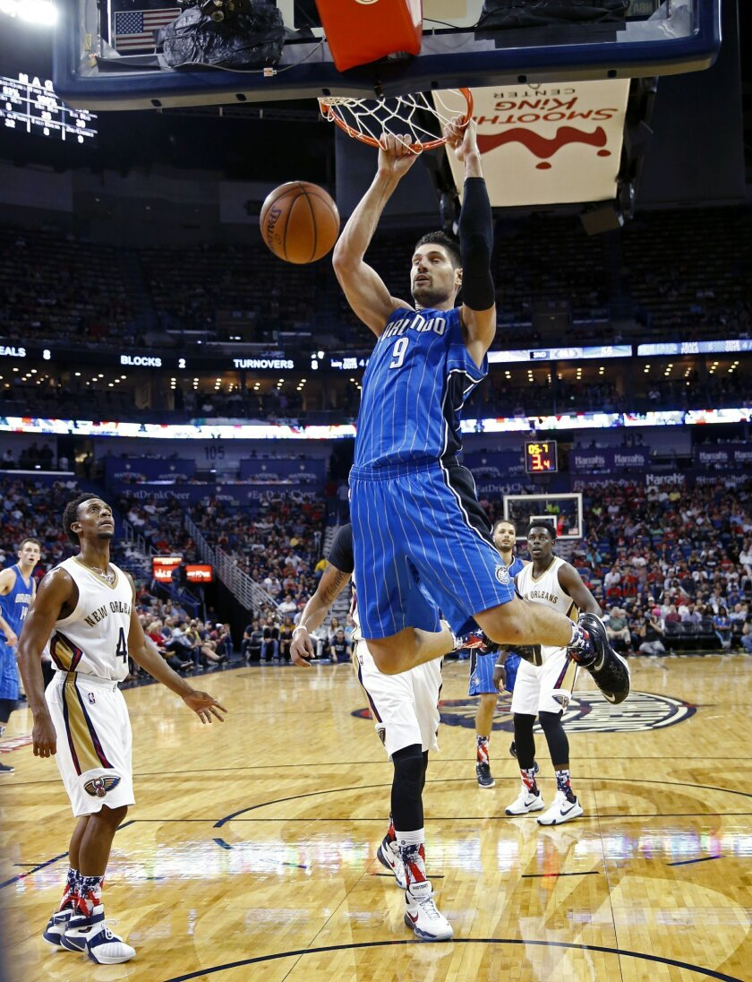Orlando Magic center Nikola Vucevic (9) slam dunks in the first half of an NBA basketball game against the New Orleans Pelicans in New Orleans, Tuesday, Nov. 3, 2015. (AP Photo/Gerald Herbert)