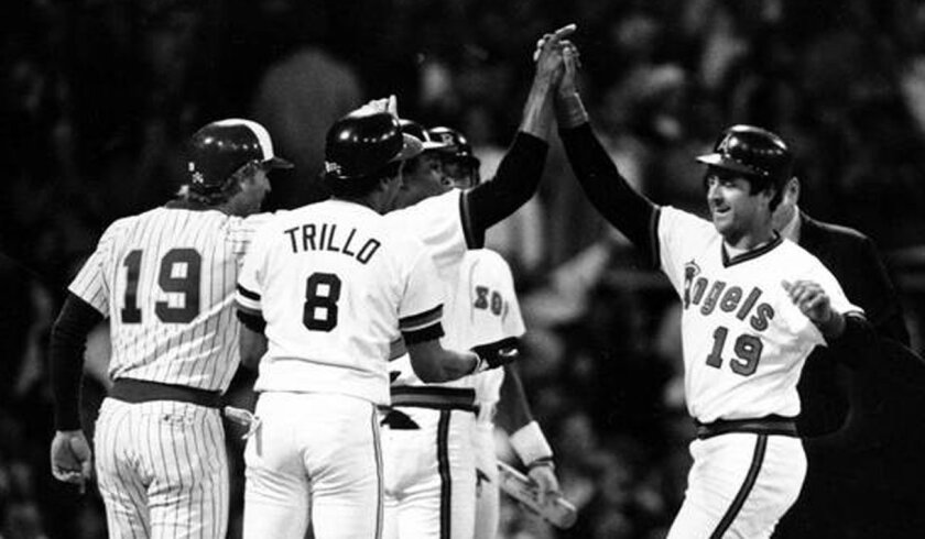 The Angels' Fred Lynn is congratulated after his grand slam in the 1983 All-Star Game at Comiskey Park.