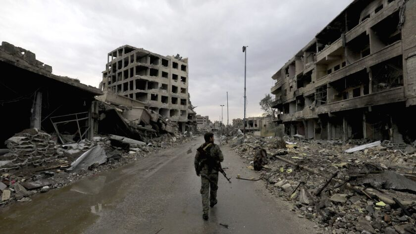 TOPSHOT-SYRIA-CONFLICT-RAQA
