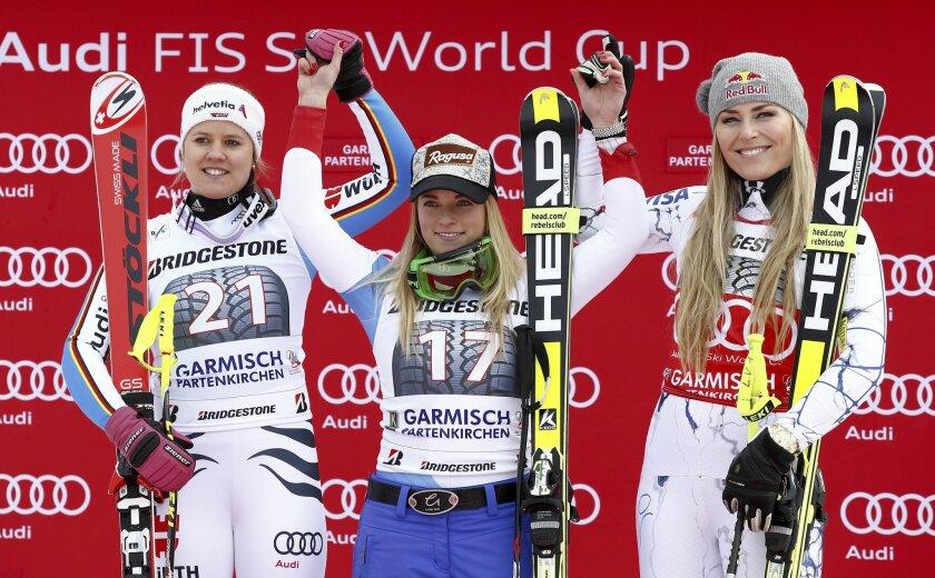 Switzerland's Lara Gut, center, winner of an Alpine ski women's World Cup Super G race, celebrates on the podium with second-placed Germany's Viktoria Rebensburg, left, and third-placed United States' Lindsey Vonn, in Garmisch Partenkirchen, Germany, Sunday, Feb. 7, 2016. (AP Photo/Gio Auletta)